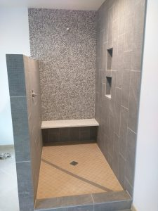 For this bathroom project (shown in progress but since completed), we mixed soft yellow floor tiles with cooler gray walls and cabinets for a style that both updates and complements the rest of the house.